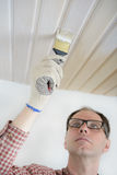 Varnishing a wooden ceiling Royalty Free Stock Photo