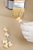 Varnishing the wooden knobs Royalty Free Stock Photography
