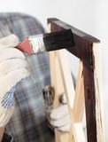 Varnishing a wooden part of furniture Stock Photography