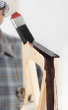 Varnishing a wooden part of furniture Stock Photo