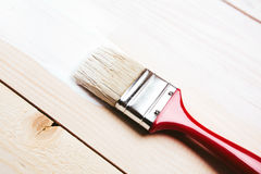 Varnishing a wooden shelf Stock Images