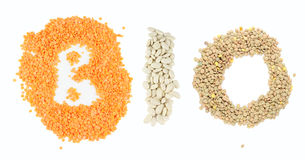 Varoius grains forming word Bio. Red lentils, beans and lentils seeds forming word Bio Royalty Free Stock Photo