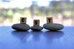 Varor och tjänst beskattar eller GST som ordet för tre bokstav Arkivfoton