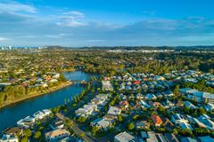 Varsity Lakes suburb and Reedy Creek at sunset. Aerial landscape of Varsity Lakes suburb and Reedy Creek at sunset. Gold Coast, Queensland, Australia royalty free stock photos