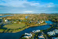 Varsity Lakes suburb and Reedy Creek at sunset. Aerial view of Varsity Lakes suburb and Reedy Creek at sunset. Gold Coast, Queensland, Australia stock images