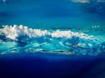 Varying shades of blue pattern the water in Caribbean islands. Varying shades of blue pattern the water in Aerial view of Caribbean islands royalty free stock photography