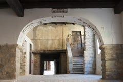 Varzi (Pavia), old buildings. Varzi (Pavia, Lombardy, Italy), ancient portico stock image