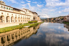 Vasari Corridor in Florence, Italy. Vasari Corridor and reflaction on the Arno river Royalty Free Stock Image