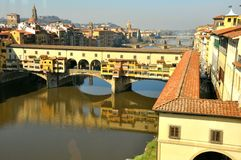 Vasari corridor and the Old bridge in Florence. Vasari's tile-roofed Corridoio running from the Uffizi on the right , across the Ponte Vecchio on its way to link Royalty Free Stock Images