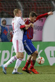 Vasas - DVSC-TEVA OTP Bank League football match. BUDAPEST, HUNGARY - MARCH 8, 2016: Duel between Martin Adam of Vasas (r) and Csaba Szatmari of DVSC during Stock Photos