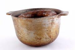 Vaschetta con porridge e la salsiccia fotografia stock