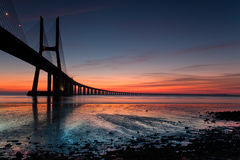 Vasco da Gama. One day before the sunrise i was at the bank of the river tejo on Lisbon to take a shot of the biggest bridge of Portugal Vasco da Gama royalty free stock image
