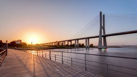 Vasco da Gama bridge during sunset and ebb-tide in. Lisbon, Portugal.  Vasco da Gama bridge is 17.2 km long and is the longest bridge in Europe. Timelapse, 4K stock video footage