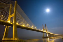 Vasco da Gama bridge under moonlight. Long Vasco da Gama bridge at night under moonlight Stock Image