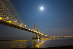 Vasco da Gama bridge under moonlight. Long Vasco da Gama bridge at night under moonlight Stock Photography