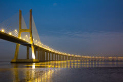 Vasco da Gama bridge under moonlight. Long Vasco da Gama bridge at night under moonlight Royalty Free Stock Photography