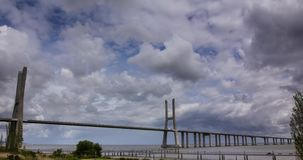 Vasco da Gama suspension Bridge timelapse HD. Long Vasco da Gama Bridge timelapse clouds moving, Portugal stock footage