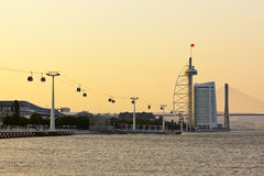 Vasco da Gama tower, bridge and cable car at Lisbon Stock Images