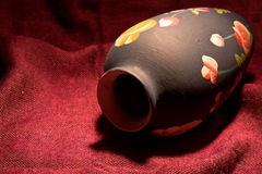 Vase. Single clay vase on the red background macro Royalty Free Stock Photos