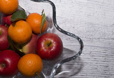 Vase with apples and mandarin oranges Stock Photos