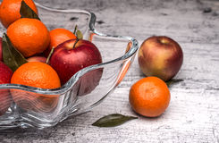 Vase with apples and mandarin oranges Royalty Free Stock Photography