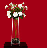 Vase with artificial flowers stock images