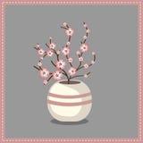 Vase avec des fleurs dans une trame Photo stock