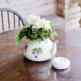 Vase of beautiful flowers on coffee table - home decor. Closeup vase of beautiful flowers on coffee table - home decor stock photo