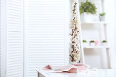 Vase with blossoming spring branches Stock Photo