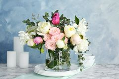 Vase with bouquet of beautiful flowers stock photography