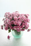 Vase with bouquet of chrysanthemums. Small vase with bouquet of chrysanthemums . tinted Stock Photo