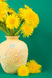 Vase with bouquet of dandelions Royalty Free Stock Images