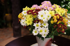 Vase with bouquet of gerbera flowers Stock Photography
