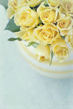 Vase with a bouquet of yellow spring roses Stock Image