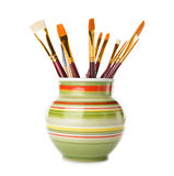 Vase with brushes Stock Photos