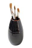 Vase with brushes of the artist Stock Photo