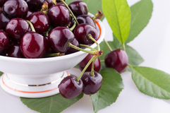 Vase with cherry. Fruit. close-up Stock Photo
