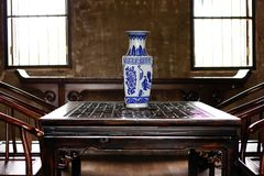 Vase ,Chinaware is on a Chinese style table. Chinaware is on a wooden table in a Chinese style room stock images