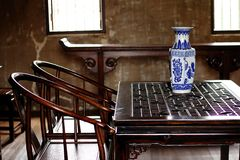 Vase ,Chinaware is on a Chinese style table. Chinaware is on a wooden table in a Chinese style room stock photo
