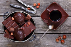 Vase with chocolate,  nuts and coffee Royalty Free Stock Images
