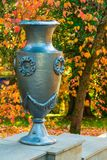 Vase closeup in Arboretum, Sochi, Russia. Vase closeup on the background of trees with dry leaves in Arboretum, Sochi, Russia Royalty Free Stock Photography