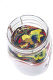 Vase of color. Processing waste in glass jar stock image