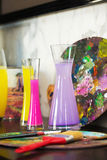Vase with colored water. palette. creative mood. artistic atmosphere Royalty Free Stock Photo