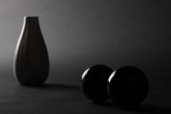 Vase in dark. White vase in the dark and two balls Royalty Free Stock Image