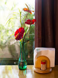Vase with red flowers on dining Table  Stock Image
