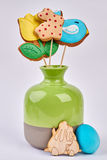 Vase with Easter cookies isolated. Wooden rabbits cutout. Share the taste of holiday Royalty Free Stock Images