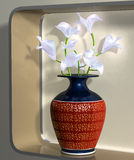 Vase of elegant flowers on a modern shelf Stock Image