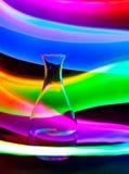 Vase en verre avec des étincelles et des vagues de lumière Photo libre de droits