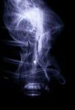 Vase en verre avec des étincelles et des vagues de lumière Image stock