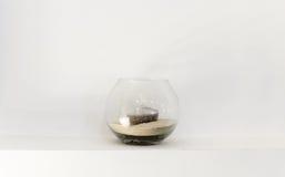 Vase en verre avec une bougie photo stock